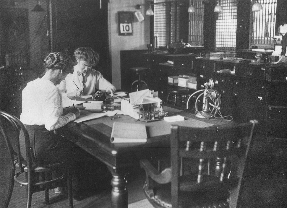 Mabel Williams,left, and Miriam Nichols at work in 1914 at the Lynn Institution for Savings, which would eventually become Eastern Bank.