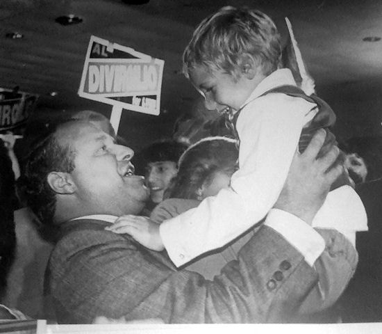 Mayor Al DiVirgilio celebrates his victory with his son, Matthew.