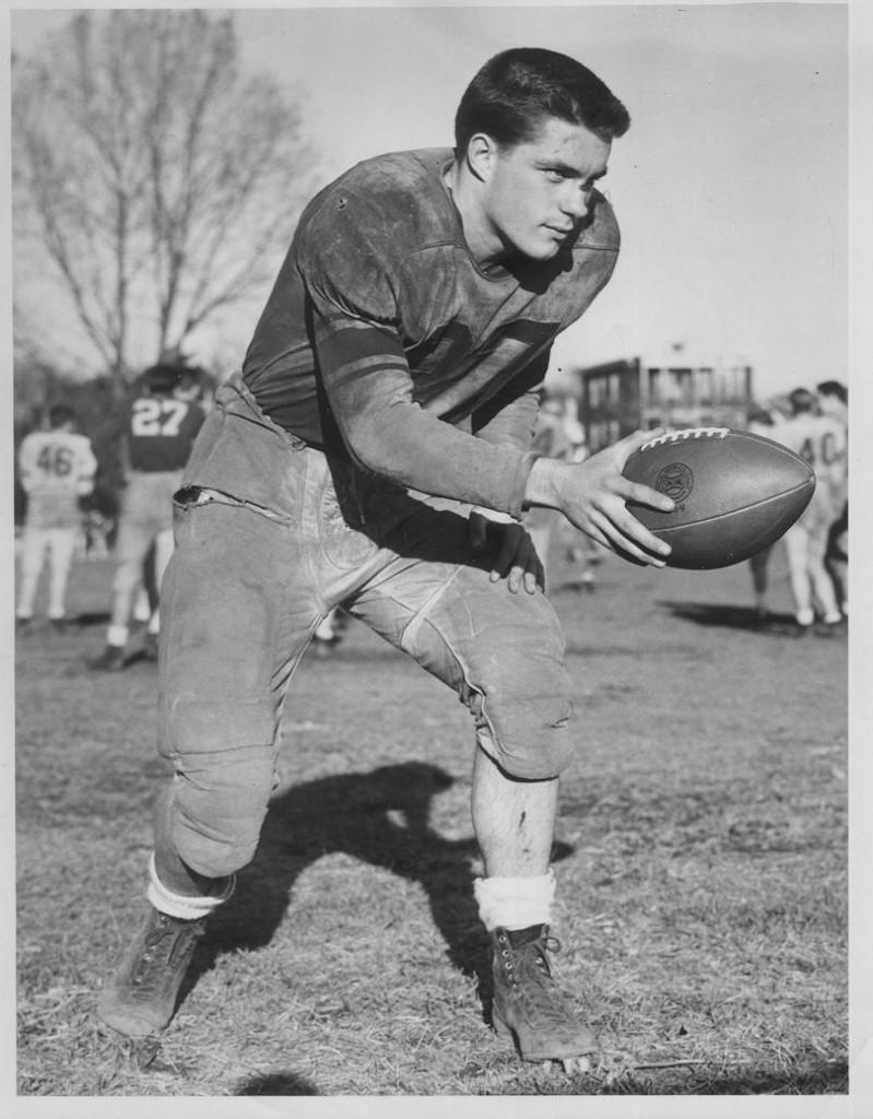John in football uniform