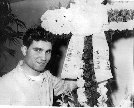 Salvy Migliaccio Sr. with flowers