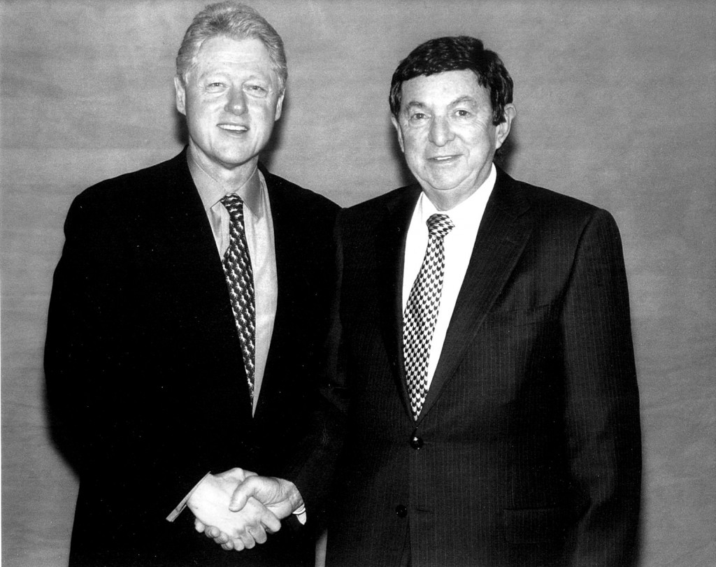 Saul Gilberg shaking hands with President Clinton