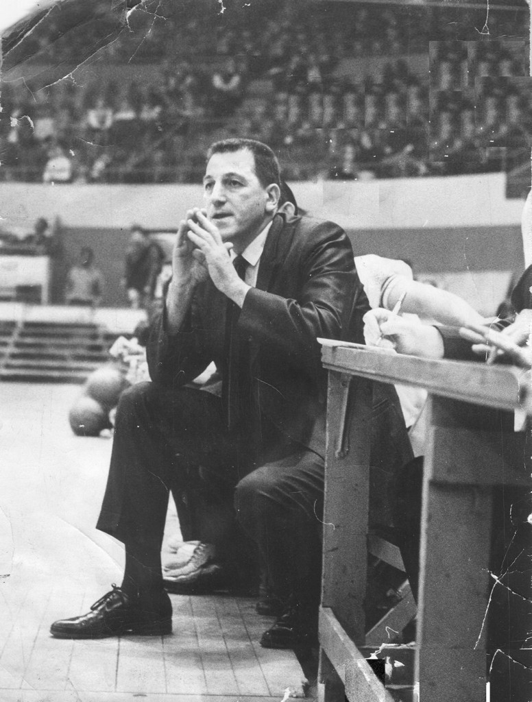 Herb Brenner coaches the Lynn Classical basketball team in a game at Boston Garden.